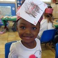 """preschool girl with """"K"""" (as in kangaroo) hat"""