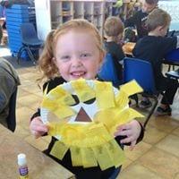 preschool girl with lion art